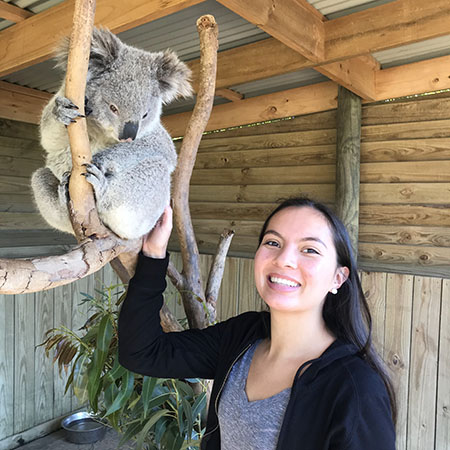 Kinesiology and Health Major, Lucy Burzynski, with a Koala while abroad.